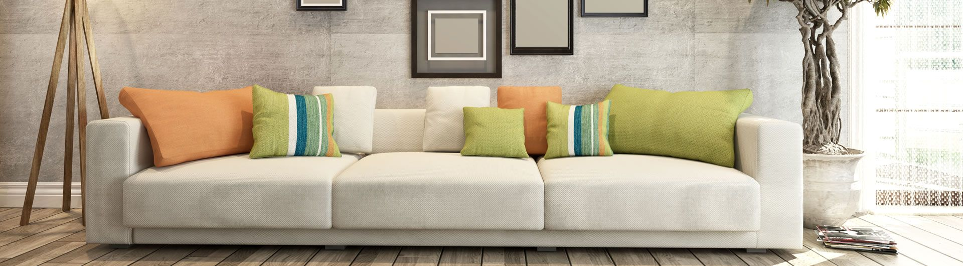 Indoor wide sofa with coloured cushions
