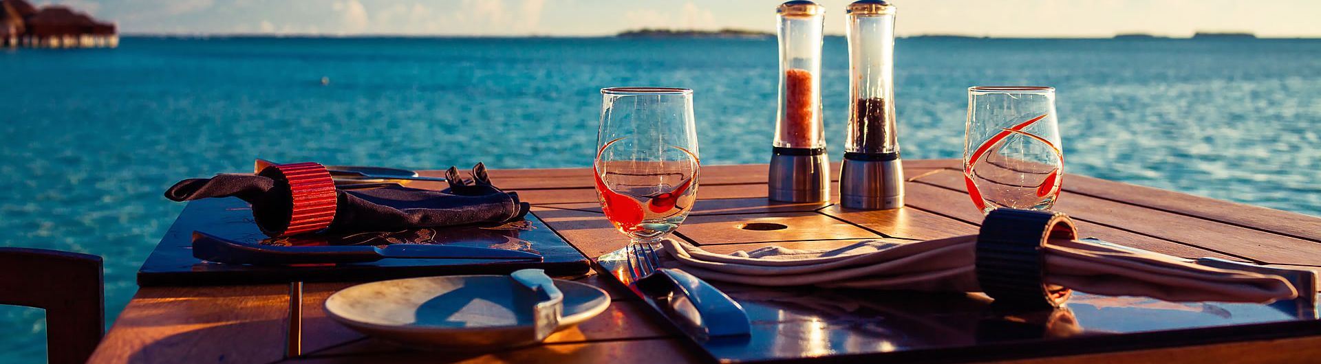 Table setting overlooking lake at sunset